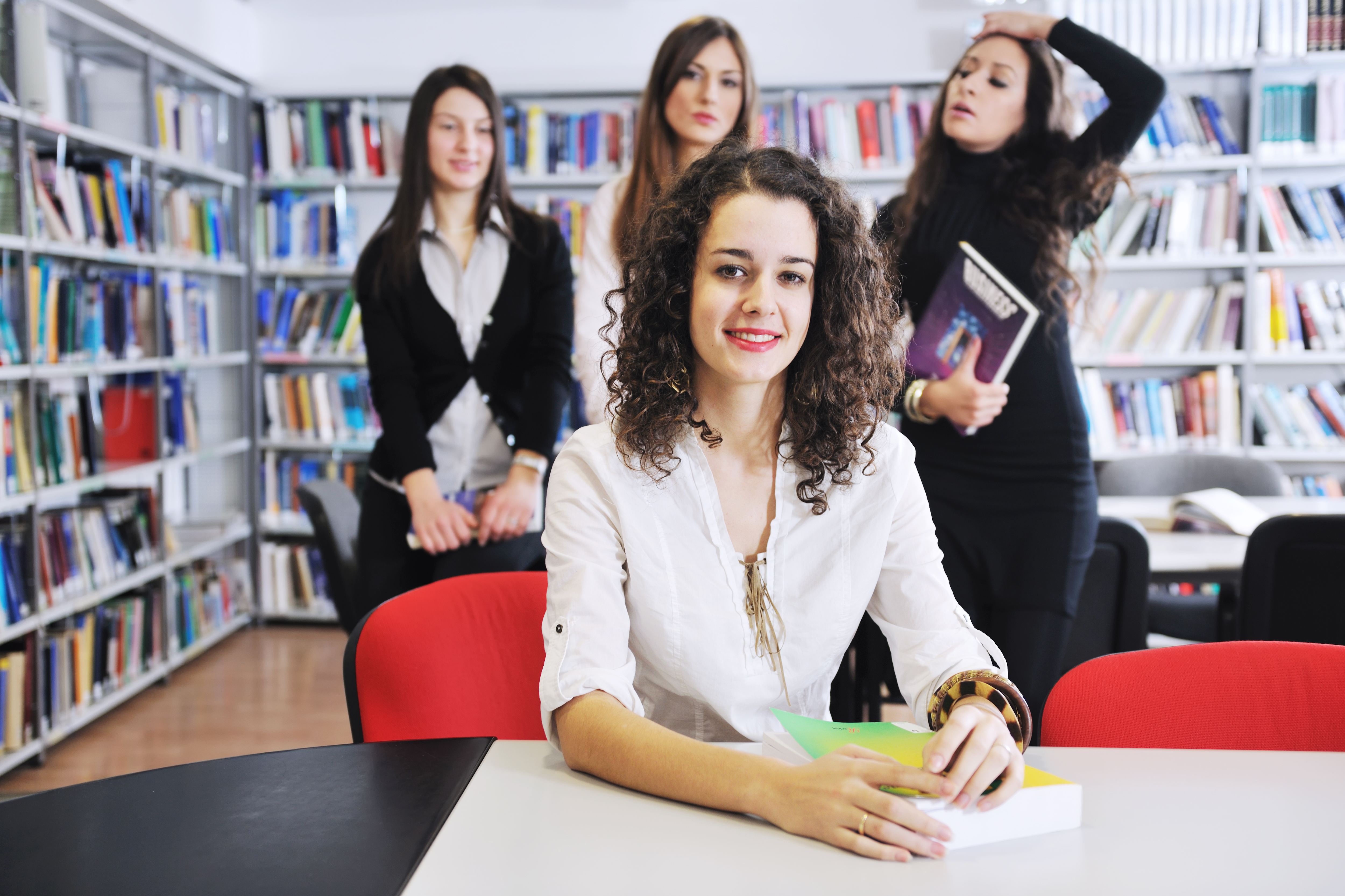 happy student woman group portrait at library